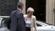 British government criticised for slow response to Hurricane Irma Downing Street EXT Theresa May MP from car and towards Number 10