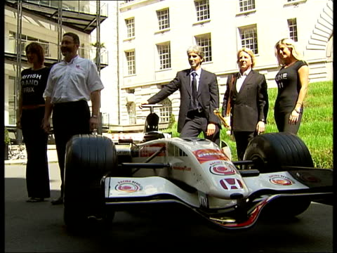 British Grand Prix Damon Hill and Rick Parfitt photocall and interviews ENGLAND London County Hall EXT Rick Parfitt and Damon Hill posing for...
