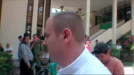 British man appears in court on drug smuggling charges INDONESIA Bali PHOTOGRAPHY*** Paul Beales escorted by police officer as along to court...