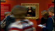 British Mona Lisa painting goes on display Group of gallery visitors viewing framed portrait of copy of 'Mona Lisa' DISSOLVE TO