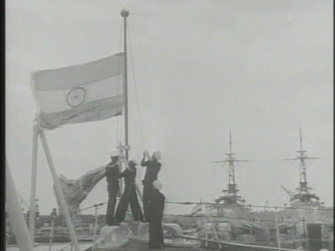 British naval officers lowering flag raising flag of India VS Lord Louis Mountbatten at ceremony w/ GovernorGeneral of Pakistan Muhammad Ali Jinnah...