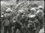 British officers standing at bend in trench watching soldiers walking by in single file Note Brief glitch in image Soldiers in trench begin to run