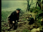 British paratroopers crouch in ditch under fire from IRA gunmen in cottage across lake which is set ablaze Carlingford Lough Ireland 1 Feb 72