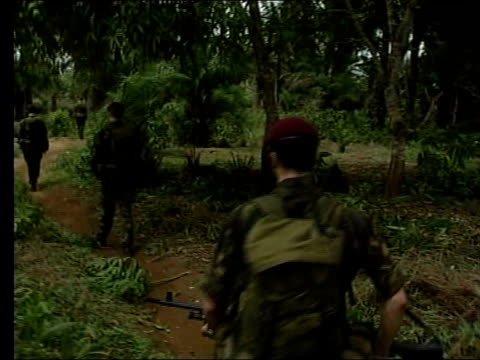 ROLE LIB British paratroopers on patrol thru jungle Paratroopers in jeep