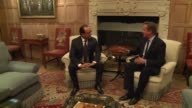 British PM David Cameron welcomes President Francois Hollande of France to Chequers