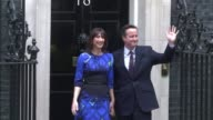 British Prime Minister David Cameron returns to Downing Street after his meeting with Queen Elizabeth