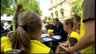 British Prime Minister David Cameron sitting down with Girl Brownies talking about what wishes the girls would like to come true