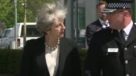 British Prime Minister Theresa May arrives at Manchesters police headquarters after a suicide bombing at a packed pop concert killed at least 22...