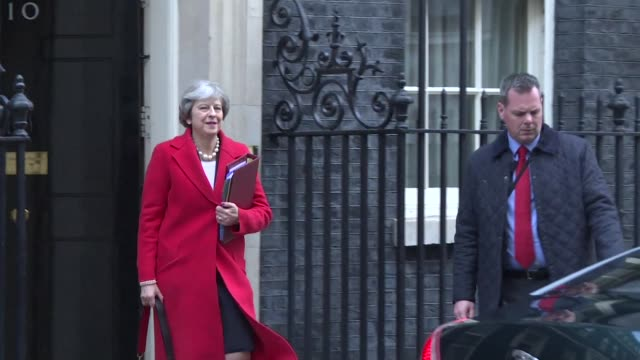 British Prime Minister Theresa May leaves Downing Street for parliament ahead of Prime Ministers Questions and the unveiling of the budget