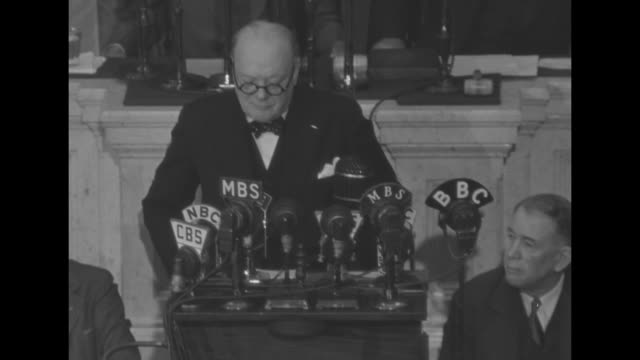 SOT British Prime Minister Winston Churchill speaking from rostrum Vice President Wallace and Speaker of House Rayburn sitting behind him re North...