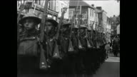 MONTAGE British soldiers marching down a city street and children walking down war-torn streets surrounded by rubble / Oxford, England, United Kingdom