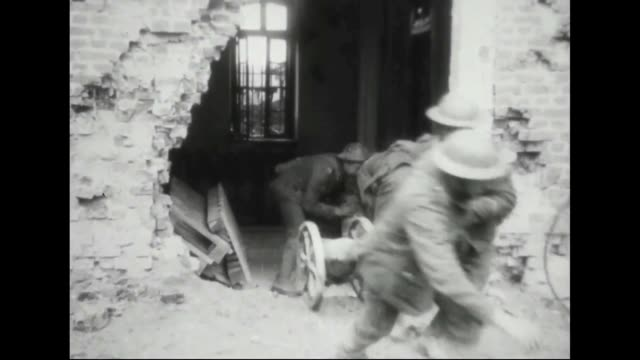 British soldiers transport shells to battery position / soldiers loading weapon