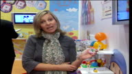 British Toy Fair at ExCel Exhibition Centre Reporter to camera