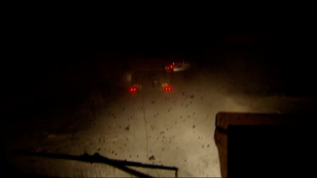 British troops on front line AFGHANISTAN Upper Sangin Valley Inkerman Forward Operating Base racking shots of bumpy road from inside vehicle /...