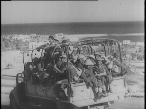 British troops on the pursuit of Nazis in North Africa / montage of troops in Libya wrecked Nazi and Italian weapons vehicles bodies / 99 planes were...