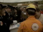 British workmen have their passports processed in France as the UK and French sections of the Channel tunnel are finally linked together 1990