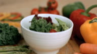 Broccoli falling into bowl in super slow motion