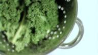 Broccoli in sieve in super slow motion