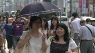 Broiling temperatures in Japan saw the mercury hit a record 41 degrees Celsius 106 Fahrenheit after at least nine people died from heatstroke over...