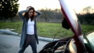Broken car and woman