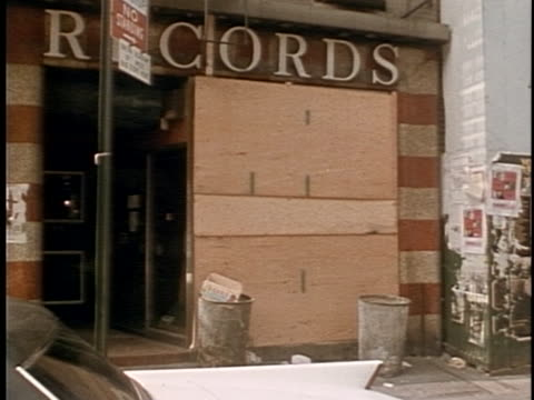 Broken glass in front of Record Store Bloody Crime Scenes in 1970s New York City