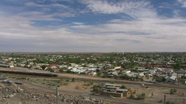 WS PAN Broken hill with houses, streets, rail tracks and cloudy sky / Broken Hill, New South Wales, Australia