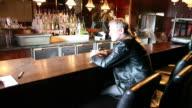 HD: Broken Man at Bar as Barman Packs Stools