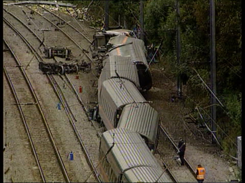 Broken rail confirmed as cause of crash LIB Hertfordshire Hatfield EXT TGVs Carriages and detached wheel sections lying across track after Hatfield...