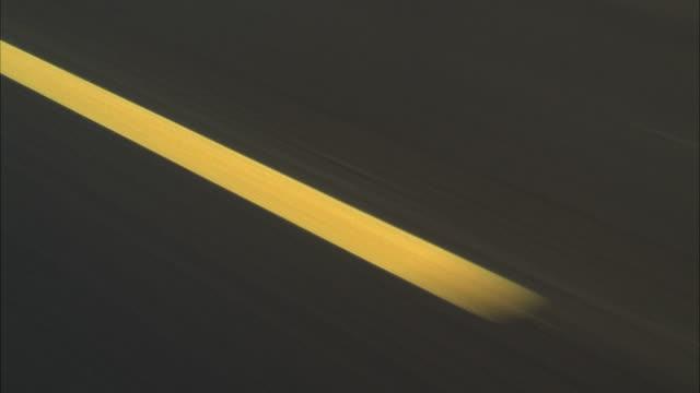 MS POV Broken yellow lines on highway road