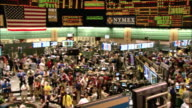 Brokers work the floor of the New York Mercantile Exchange. Available in HD.