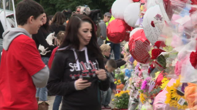 Broll and SOTs from informal 'memorial' at MarysvillePilchuck High School in Washington state where three students died in a shooting incident