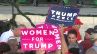 broll of audience waiting for Donald Trump Mike Pence to speak during thank you tour in Orlando Florida signs