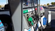 Broll of gas price signs and pump/meter around Las Vegas Retail gasoline prices continued to inch down in the Las Vegas Valley over the past week...