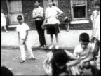 1965 MONTAGE Bronx neighborhood street scenes / New York City, New York, United States