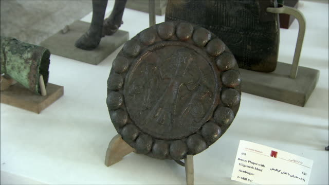 CU ZI Bronze plaque with Gilgamesh in National Museum of Iran, Tehran, Iran