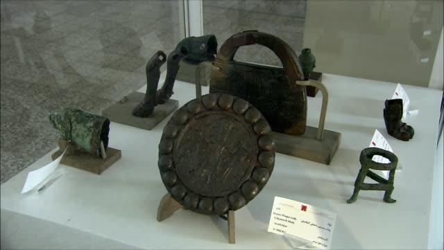 MS Bronze plaque with Gilgamesh in National Museum of Iran, Tehran, Iran