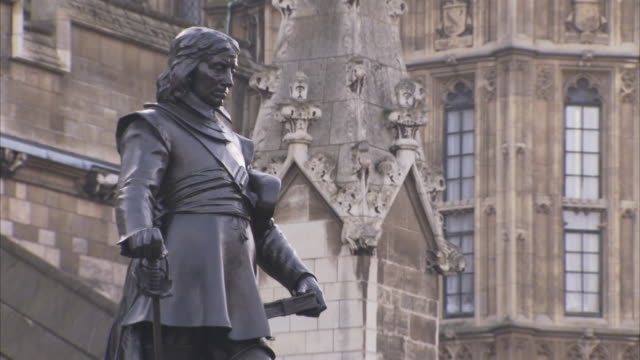 A bronze statue outside Parliament depicts Oliver Cromwell holding a sword and a Bible.