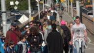 Brooklyn Bridge and Crowds of Tourists Walking
