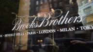 Brooks Brothers signage and window display at store location in New York New York United States on September 25 Wide shots and close ups of 'Brooks...