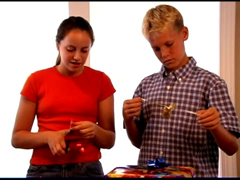 Brother and sister wrapping gift