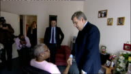 Brown and Burnham visit elderly care home in Stockwell ENGLAND London Stockwell EXT **flash photography throughout* Gordon Brown and Andy Burnham MP...