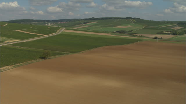 AERIAL WS ZI Brown fields and surrounding vineyards / Chablis, France