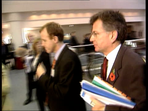 Brown tax breaks for managers ITN ENGLAND Birmingham INT i/c Overseas Development Minister Clare Short MP sitting talking with man at CBI conference...