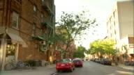 Brownstone apartment buildings on Brooklyn street unidentifiable people Neighborhood NYC