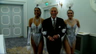 Bruce Forsyth celebrates 80th birthday ENGLAND London Dorchester Hotel PHOTOGRAPHY * * Bruce Forsyth along thru doors with Miss England and Miss...