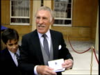 Investiture POOL ENGLAND London Buckingham Palace Bruce Forsyth showing off OBE medal CS OBE medal Bruce Forsyth interviewed the Queen said it gives...