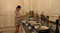 Brunette Woman İs Getting Food from Buffet