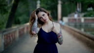 Brunette woman with tattoos video portrait