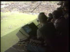 BSkyB live soccer deal TX 11293 ITN INT STADIUM TBV Commentator at work watching match TX