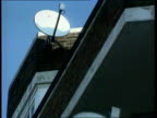 BSkyB live soccer deal TX LA MS Satellite dish affixed to top of bldg PULL OUT another below ENGLAND Twickenham MS SIDE TV camera on touchline of...